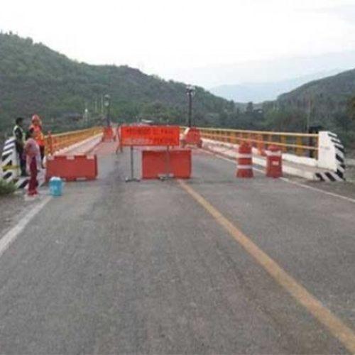 Cierran provisionalmente paso vehicular en puente de Tequisistlán.
